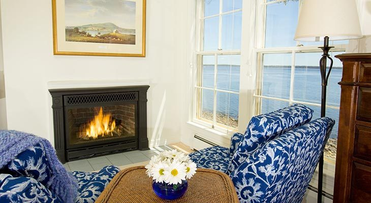 The fireplace in the Fitz Henry Lane Cottage at our oceanfront bed and breakfast in Maine