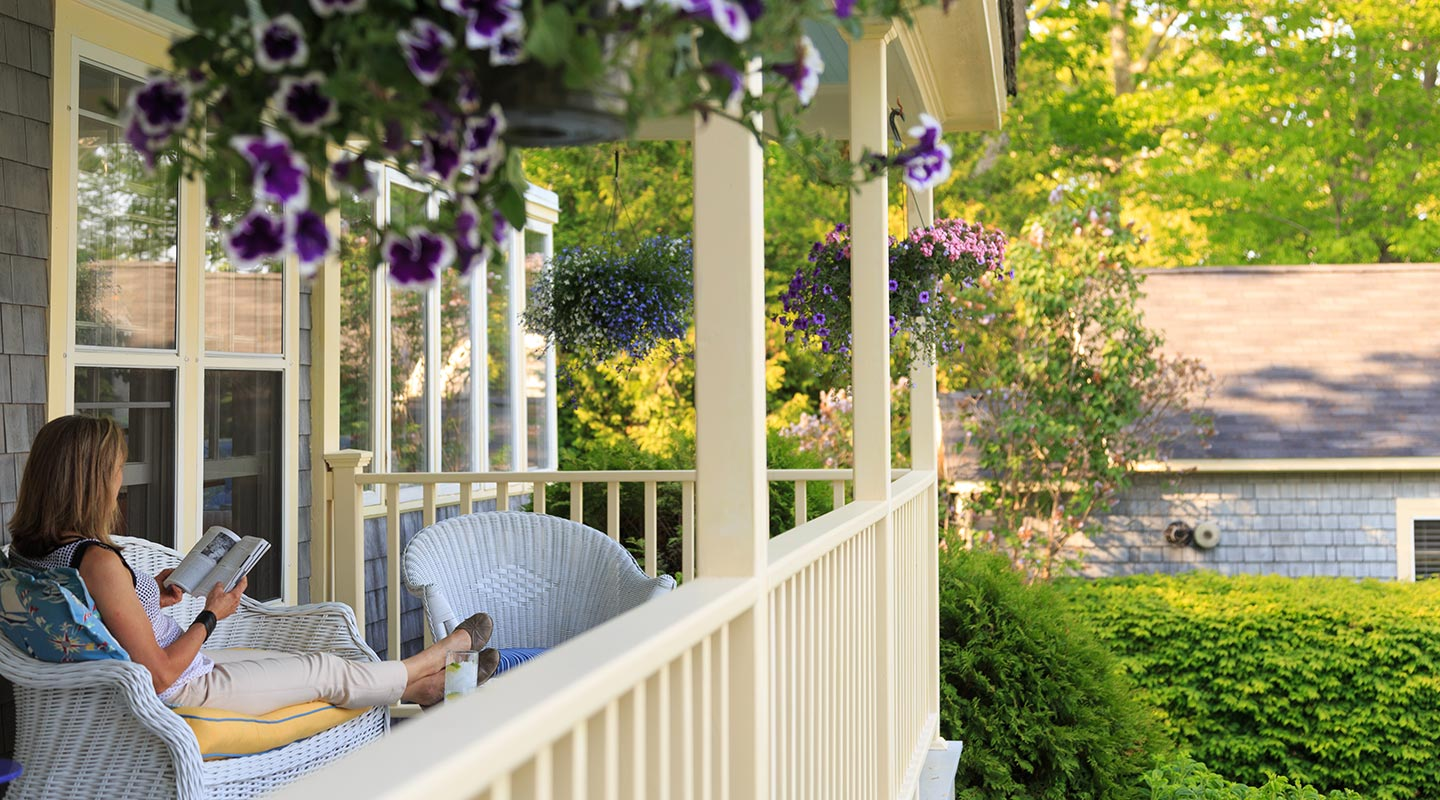 Relaxing on the porch at our Maine boutique hotel