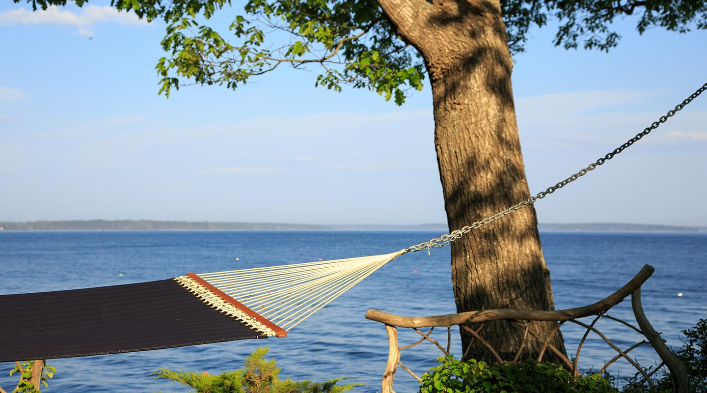 View romantic getaways in Maine, relax in a hammock by the ocean