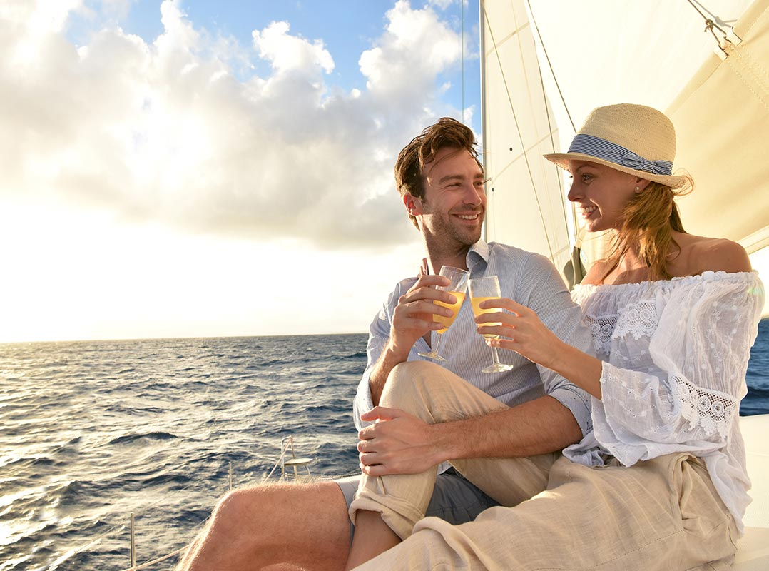 Couple toasting on a sailboat