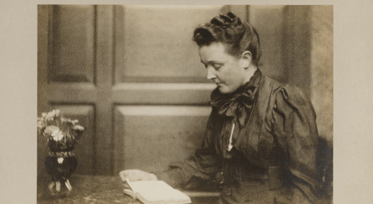 Old photo of a woman reading a book