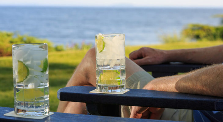 Refreshing cocktail on the arm of a beach chair