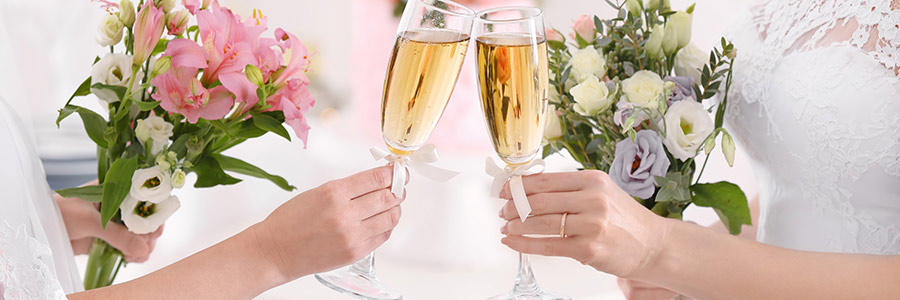 two brides toasting with champagne