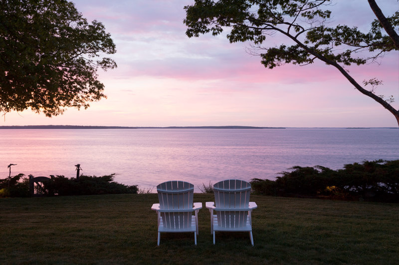 two chairs pointed at Maine sunrise view