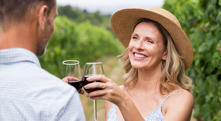 a couple wine tasting at a vineyard